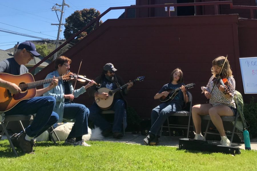 Celtoid musicians play instruments at St. Mary's church in Pacific Grove, CA