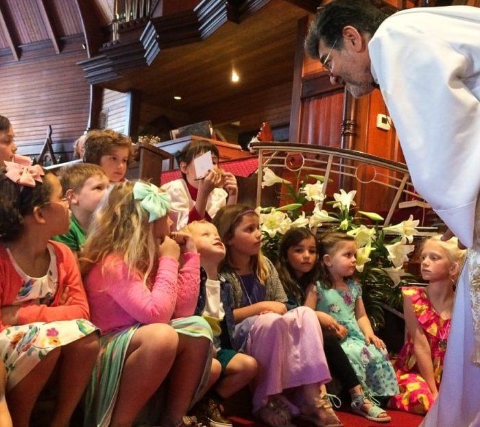 Group of children listen during Sunday School exercise