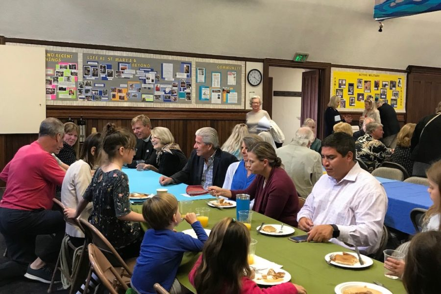 Riedels and Stroms eating at the St. Mary's Pancake Breakfast, October 14, 1028