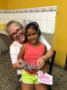 """Kirsten Matsumoto hugs a child from """"Our Little Roses"""" group"""