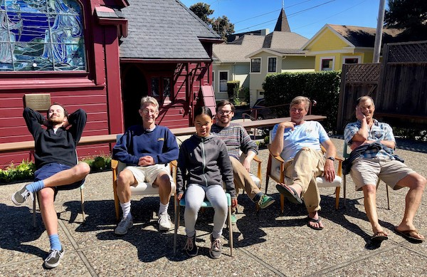 A well-deserved rest for St. Mary's official chair testing team, pictured during our recent work day.