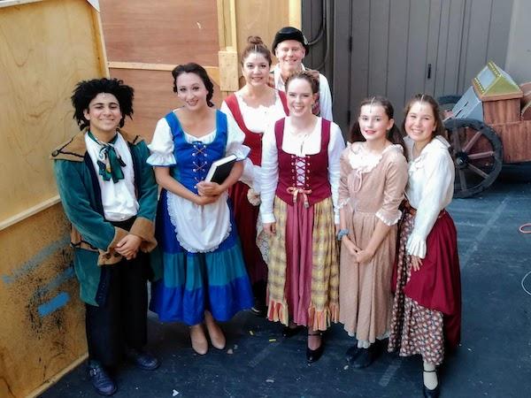 "Photo left to right: Andrew Mansour as ""LeFou,"" Claire Moorer as ""Belle,"" Jennifer Nix, Kelly Nix as ""Baker,"" Rebecca Bruemmer, Scarlett Nix, Madalena Taurke"