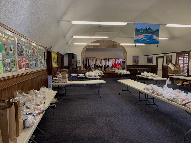 Pre-packaged food bags from the Monterey County Food Bank inside St. Mary's parish hall. Photo courtesy of Zach Goodwin.