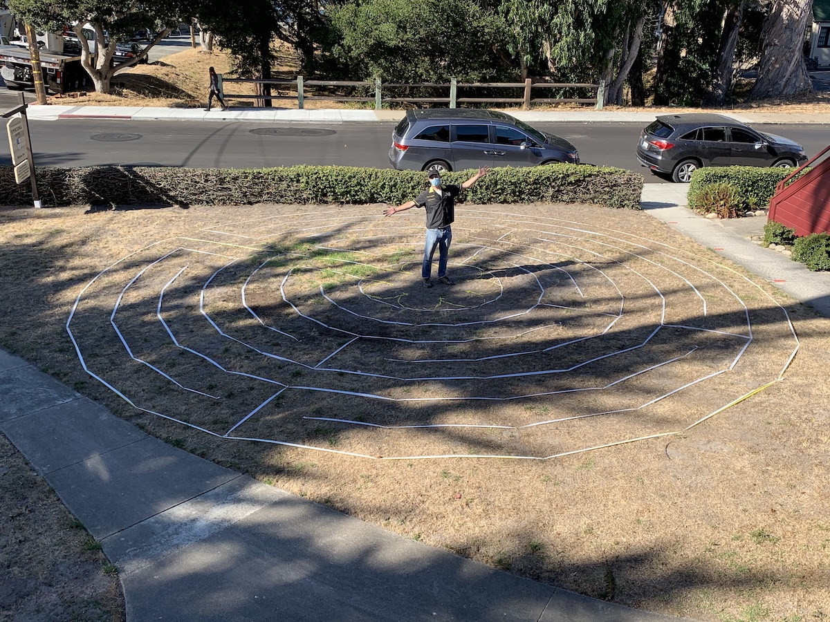 Lars Howlett stands in the center of the new Labrynth he designed for St. Mary's By-The-Sea in Pacific Grove, CA
