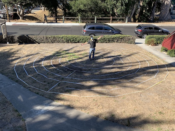 Lars Howlett stands in the center of the new Labyrinth he designed for St. Mary's By-The-Sea in Pacific Grove, CA