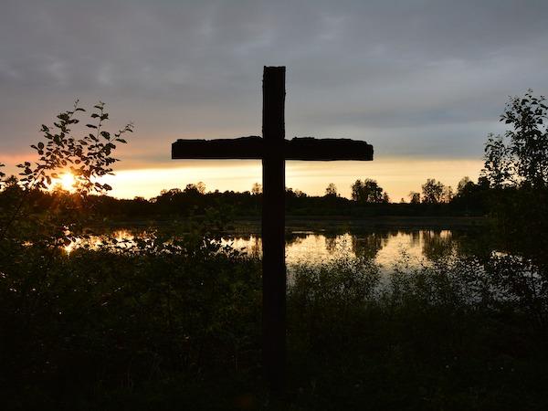 Cross agains sunrise