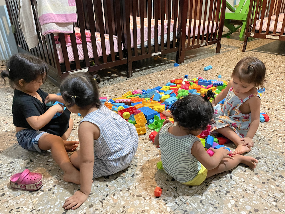 Our Little Roses playing with Duplo blocks