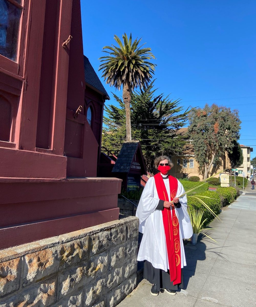Pastor Kristine handed out palm fronds in front of the church before the Palm Sunday service. The service included a virtual procession with palms and the passion play according to Mark.