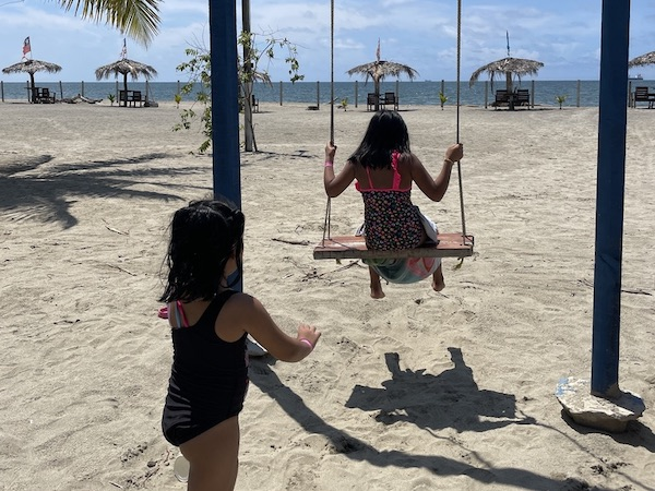 Our Little Roses playing on the swings at 2021 Virtual Summer Camp